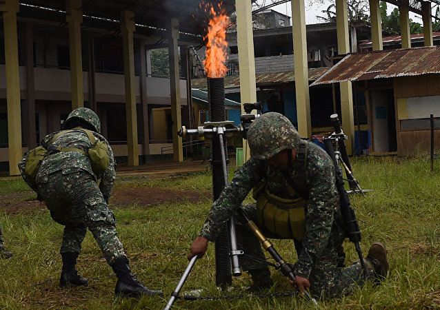 Philippine Marines fire 81mm mortars at Muslim militant positions at the frontline in Marawi, on the southern island of Mindanao on July 22, 2017