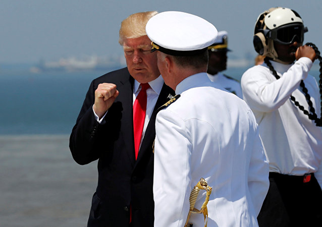 US President Donald Trump bids farewell to US Navy Captain Richard McCormack after commissioning the aircraft carrier USS Gerald R. Ford during a ceremony at Naval Station Norfolk in Norfolk, Virginia, US July 22, 2017.