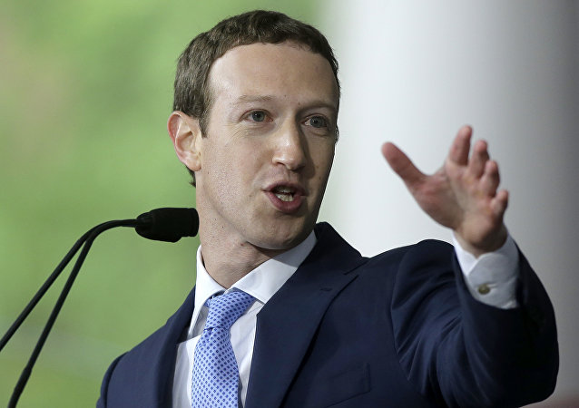 In this May 25, 2017, file photo, Facebook CEO and Harvard dropout Mark Zuckerberg delivers the commencement address at Harvard University commencement exercises in Cambridge, Mass.