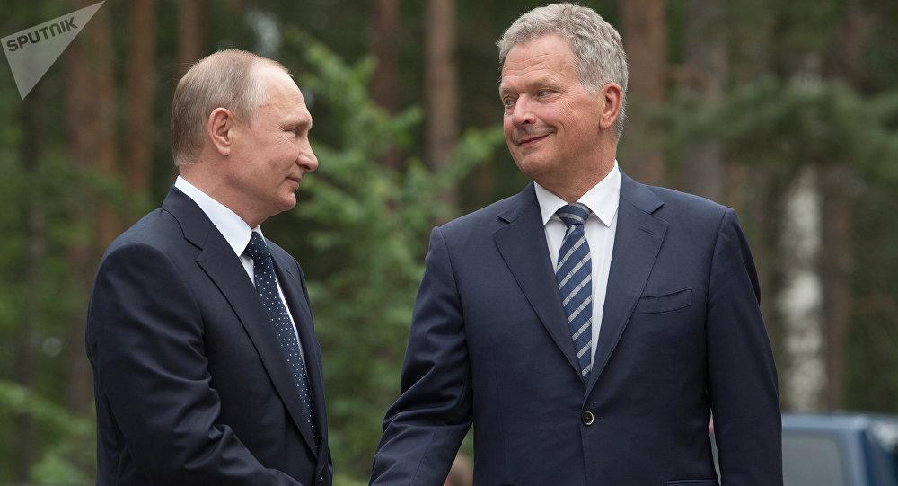 Russian President Vladimir Putin and President of Finland Sauli Niinisto, right, during their meeting