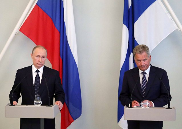 Russian President Vladimir Putin and President of Finland Sauli Niinisto during a press conference in Savonlinna
