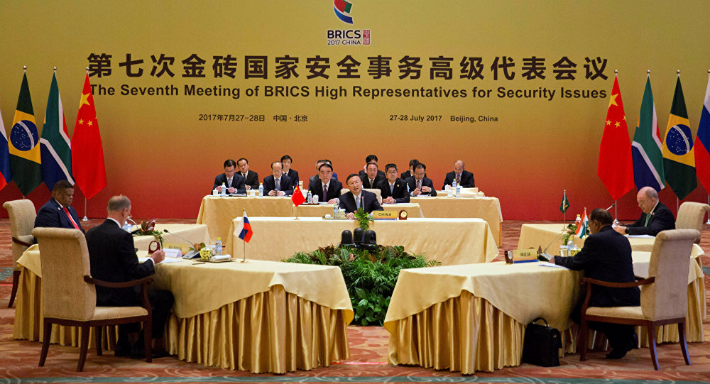 Chinese State Councilor Yang Jiechi, center hosts the seventh meeting of BRICS senior representatives on security issues held at the Diaoyutai state guesthouse in Beijing, China, Friday, July 28, 2017.