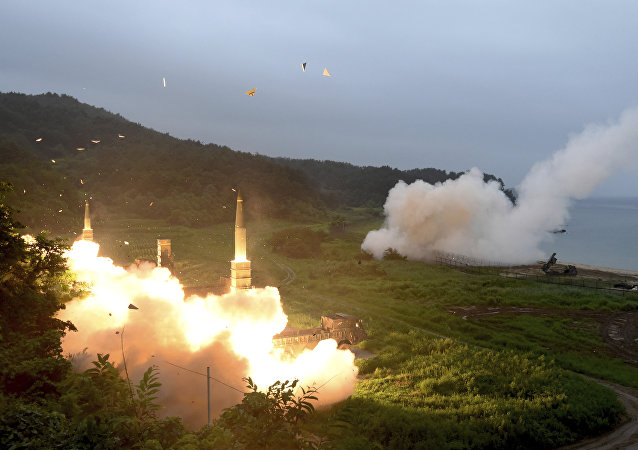 In this photo provided by South Korea Defense Ministry, South Korea's Hyunmoo II Missile system, left, and U.S. Army Tactical Missile System, right, fire missiles during the combined military exercise between the two countries against North Korea at an undisclosed location in South Korea, Saturday, July 29, 2017.