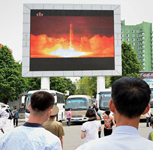 People watch news report showing North Korea's Hwasong-14 missile launch on electronic screen at Pyongyang station, North Korea in this photo taken by Kyodo on July 29, 2017