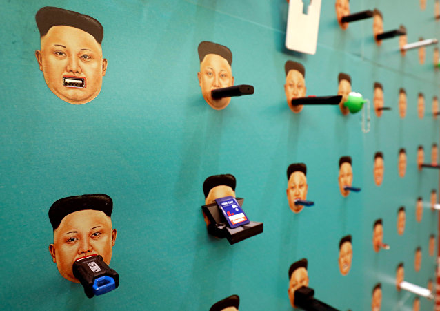 Donated flash drives are shown with images of North Korean leader Kim Jong-un on Human Rights Foundation's Flash Drives for Freedom wall during the Def Con hacker convention in Las Vegas, Nevada, U.S. on July 29, 2017