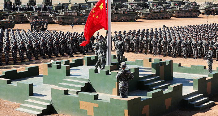 Soldiers of China's People's Liberation Army (PLA) raise a Chinese national flag during the military parade to commemorate the 90th anniversary of the foundation of the army at Zhurihe military training base in Inner Mongolia Autonomous Region, China, July 30, 2017