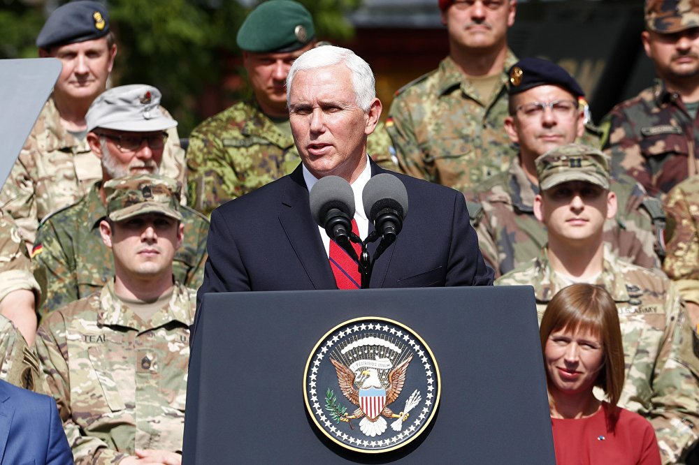 US Vice President Mike Pence delivers a speech next to Estonia's President Kersti Kaljulaid as they visit NATO's Enhanced Forward Presence mission and Estonian troops in Tallinn, Estonia July 31, 2017.