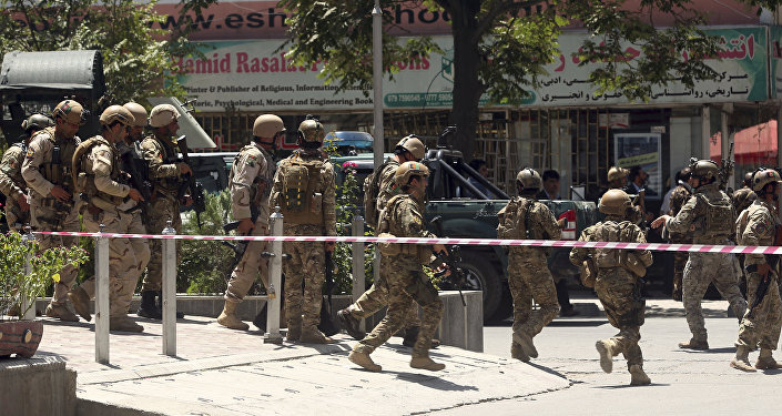 Security forces respond at the site of a suicide attack followed by a clash between Afghanistan's forces and IS fighters during an attack on Iraq embassy in Kabul, Afghanistan, Monday, July 31, 2017