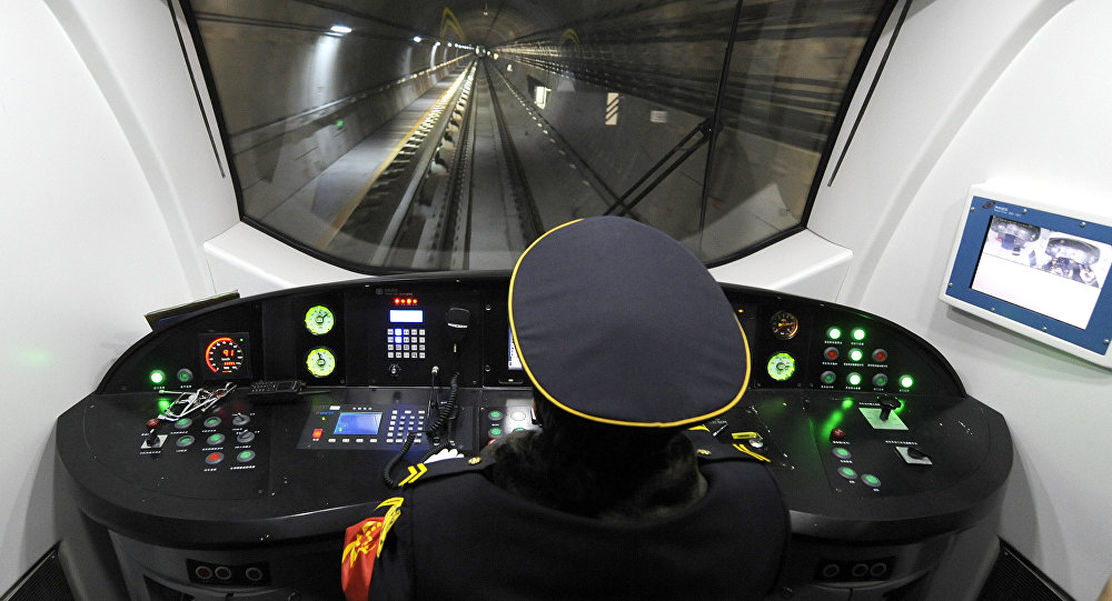 A driver operates a metro car runing through the newly-opened subway line in Beijing on December 30, 2010