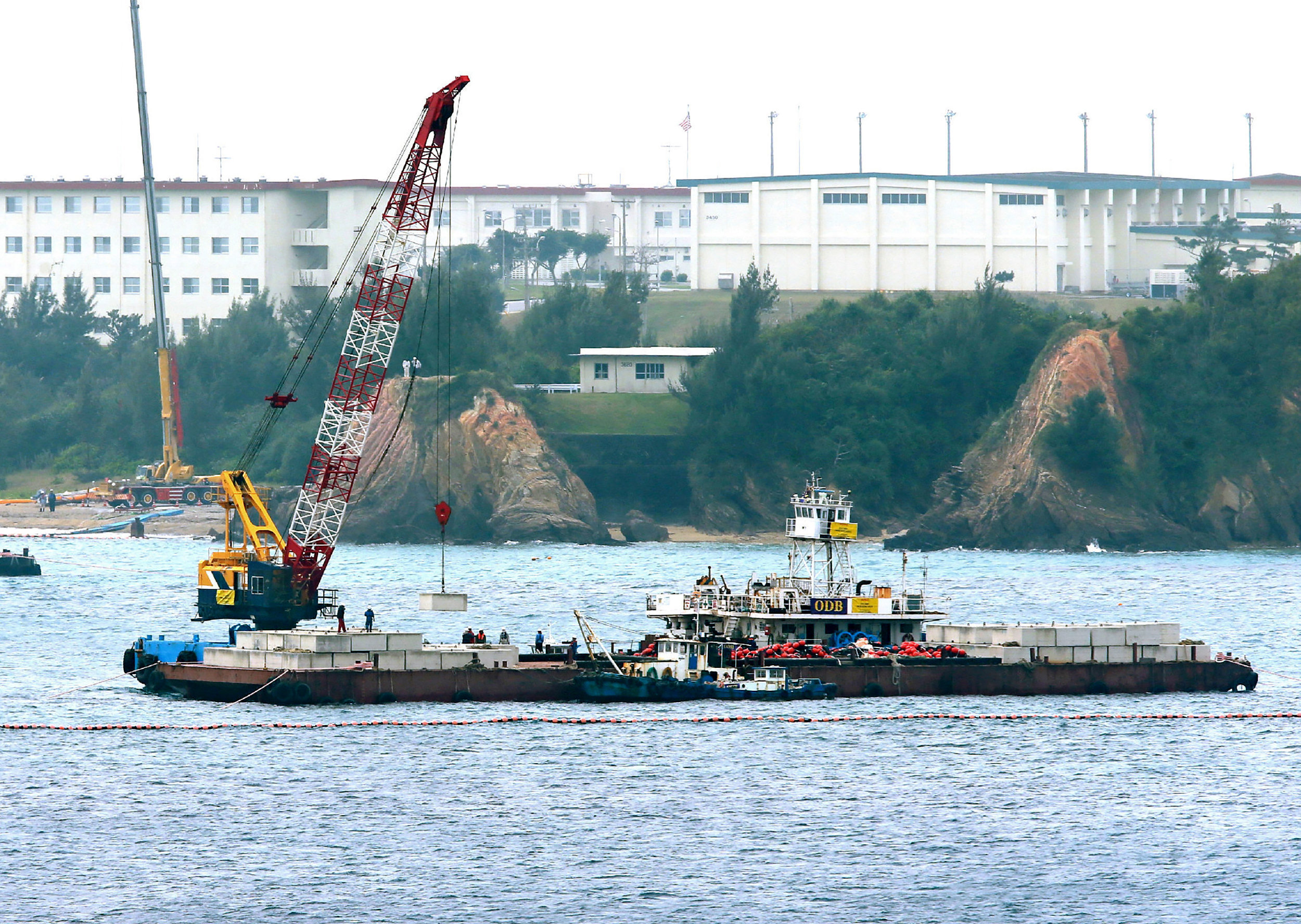 A crane barge works in the Henoko coastal area in Nago, Okinawa prefecture on February 6, 2017