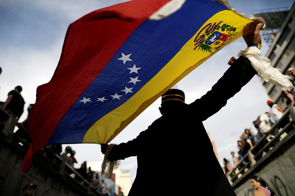 Opposition supporters attend a rally to pay tribute to victims of violence during protests against Venezuelan President Nicolas Maduro's government in Caracas, Venezuela, July 24, 2017.