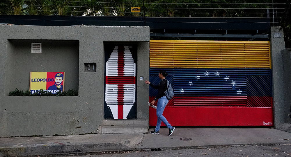 A woman walks in front of the house of Venezuelan opposition leader Leopoldo Lopez in Caracas, Venezuela August 1, 2017