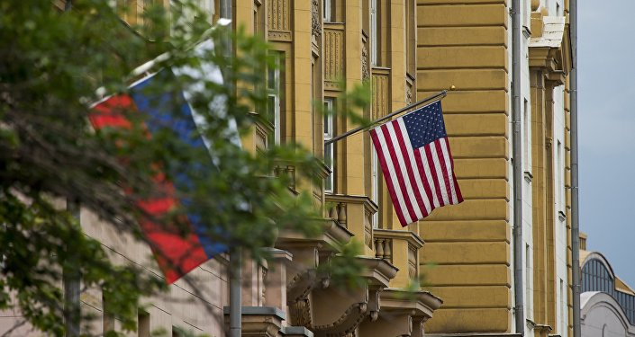 U.S. and Russian flags hung at the U.S. Embassy in Moscow, Russia, Friday, July 28, 2017