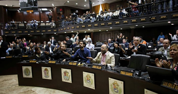 Opposition lawmakers shout Fraud, fraud during a session of Venezuelan National Assembly in Caracas, Venezuela, Wednesday, Aug. 2, 2017. The CEO of the voting technology company Smartmatic said Wednesday that results of Venezuela's election for an all-powerful constituent assembly were off by at least 1 million votes