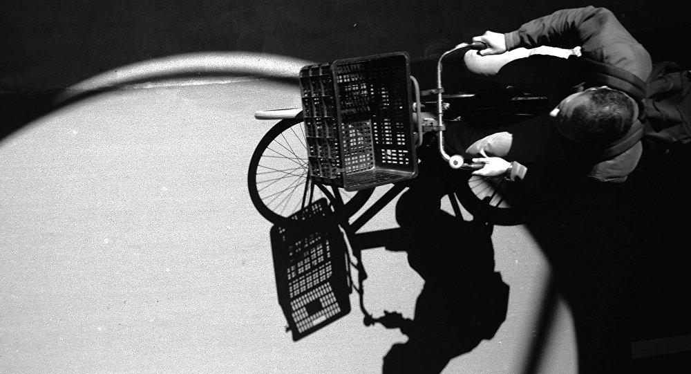 A man riding a bike