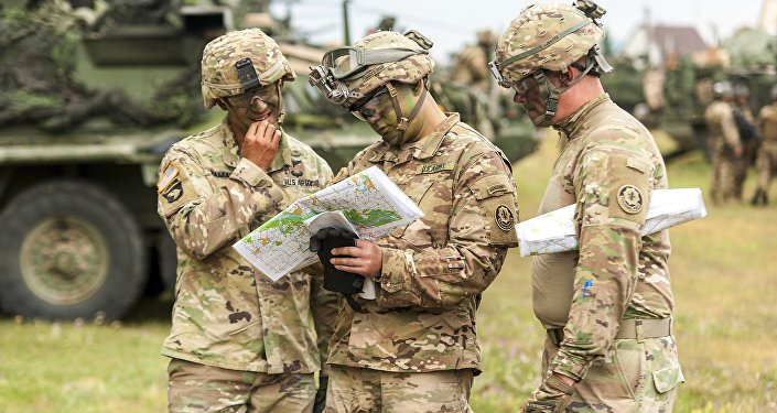 In this July 3, 2017 file photo, American soldiers get ready for NATO's Saber Guardian exercises, checking a map near Gyor, 120 kilometers west of Budapest, Hungary.