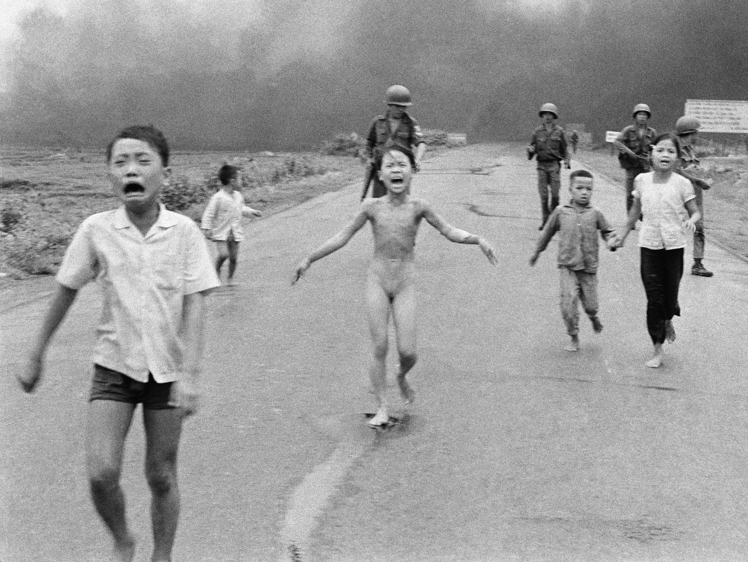 This is a June 8, 1972 file photo of South Vietnamese forces follow after terrified children, including 9-year-old Kim Phuc, center, as they run down Route 1 near Trang Bang after an aerial napalm attack on suspected Viet Cong hiding places