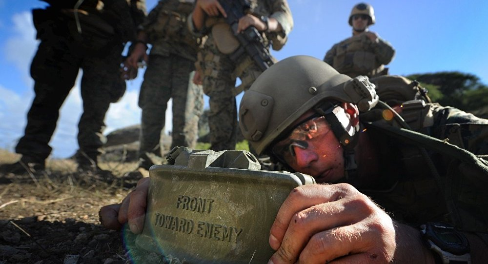 Sergeant Anthony Jacks placed a claymore mine during a combat shooting on September 20, 2009. (File)