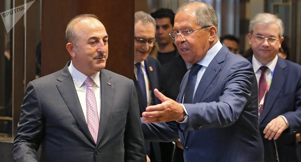 From right: Russian Foreign Minister Sergei Lavrov meets with Turkish Foreign Minister Mevlut Cavusoglu