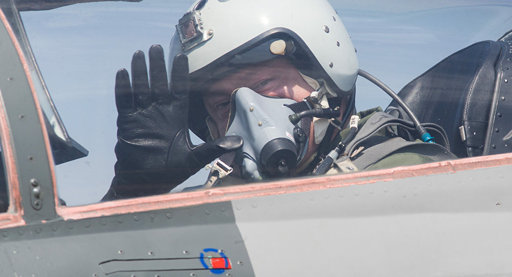 Ukrainian President Petro Poroshenko waves from the cockpit of a MiG-29 fighter jet before taking off from the military airfield in the village of Vasylkiv, outside Kiev, Ukraine