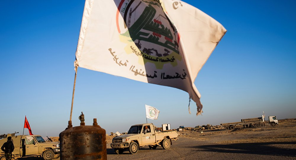 Members of the Hashd Al Shaabi (Popular Mobilisation Units) are seen on the tarmac of the Tal Afar airport on November 20, 2016