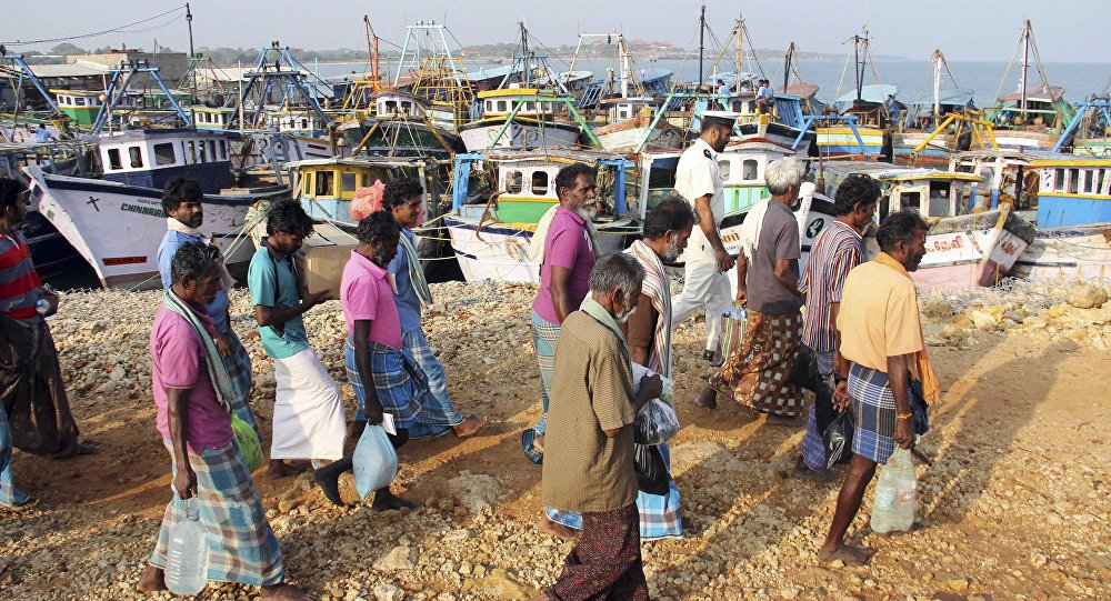 (File) A group of Indian fishermen walk towards their vessels after being released in Jaffna, Sri Lanka, Monday, March 17, 2014