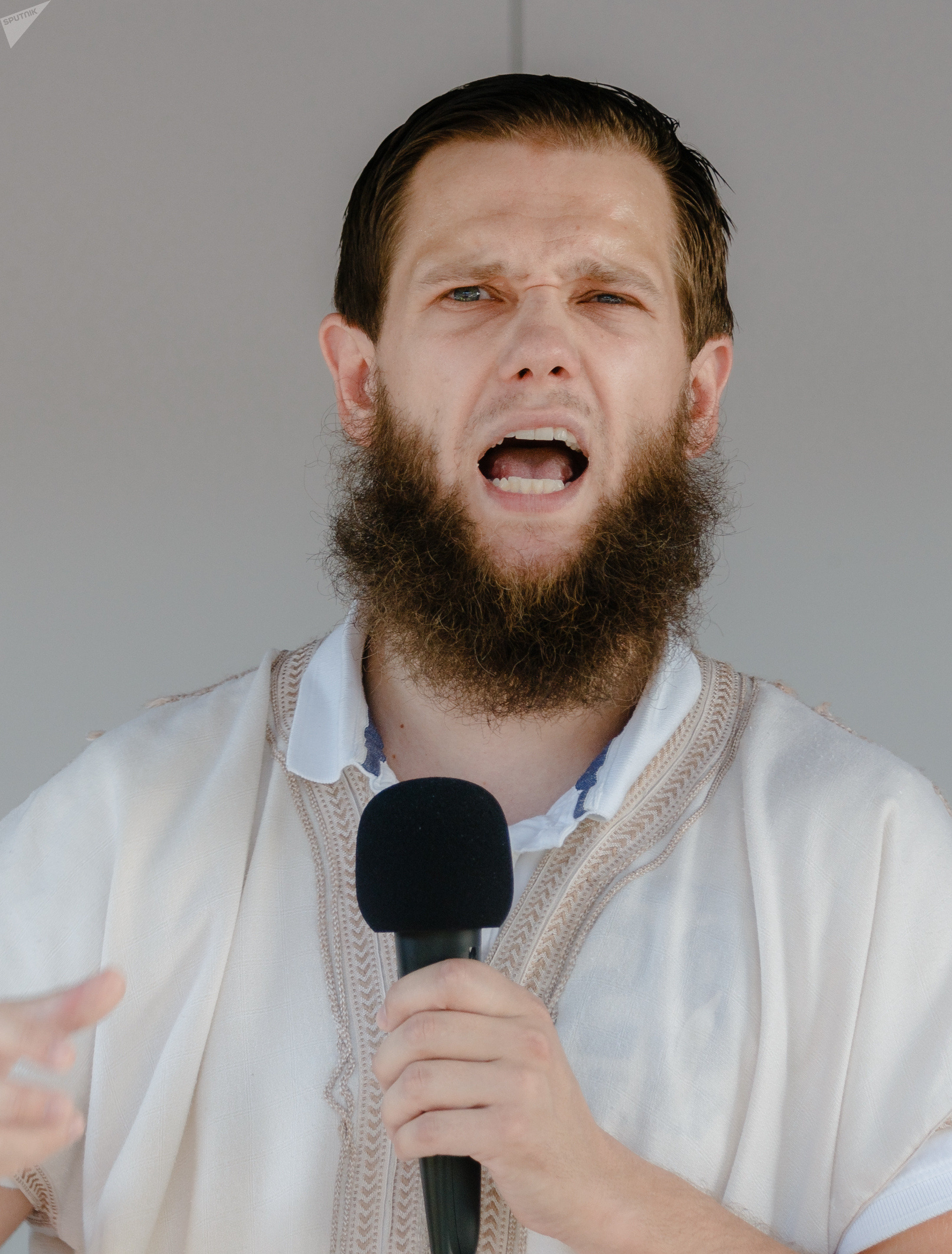 Islamist preacher Sven Lau aka Abu Adam talks during a rally on July 19, 2014 in Hamburg, northern Germany.