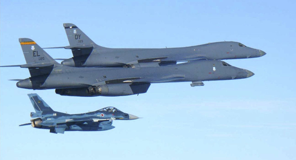 In this photo released by Japan Air Self Defense Force, U.S. Air Force B-1B bombers, top, fly with a Japan Air Self Defense Force F-2 fighter jet over Japan's southern island of Kyushu, just south of the Korean Peninsula, during a Japan-U.S. joint exercise Sunday, July 30, 2017.