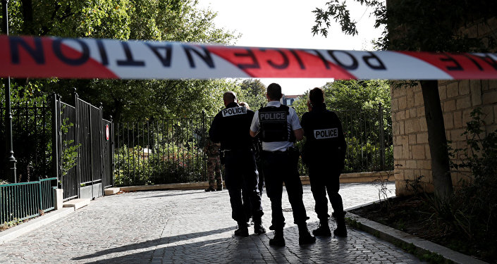 Police secure a street near the scene where French soliders were hit and injured by a vehicle in the western Paris suburb of Levallois-Perret, France, August 9, 2017