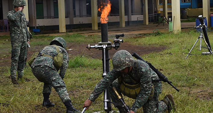 Philippine Marines prepare to fire 81mm mortars at Muslim militant positions at the frontline in Marawi on the southern island of Mindanao