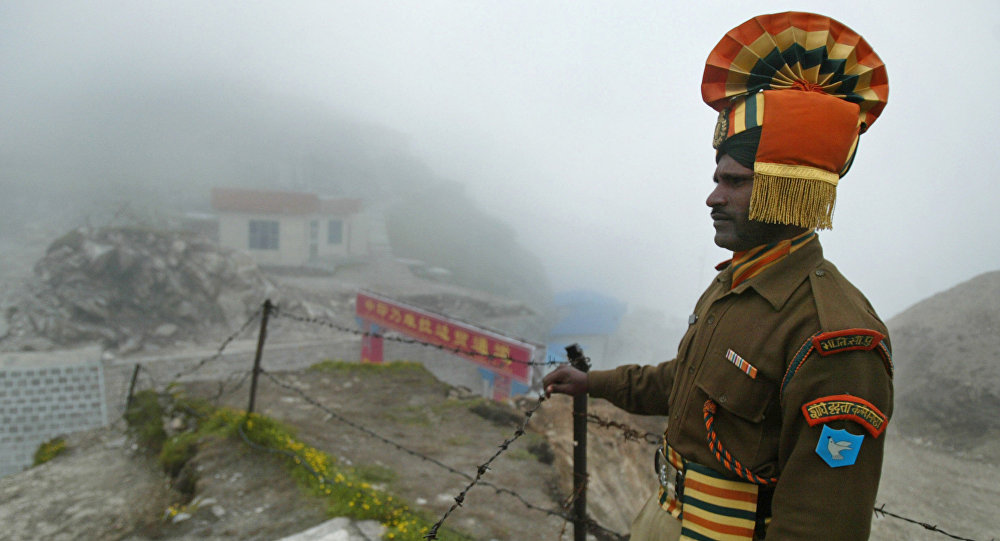 In this photograph taken on July 10, 2008 an Indian soldier stands guard at the ancient Nathu La border crossing between India and China