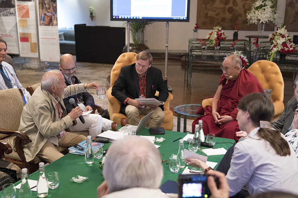 Russian scientist David Dubrovsky converses with Dalai Lama during a conference in New Delhi