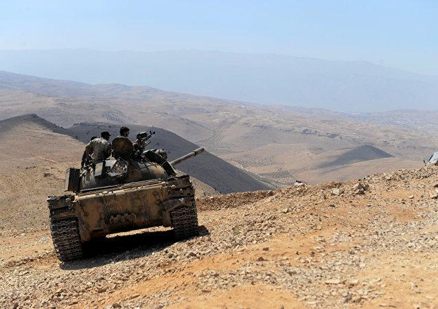 A Syrian tank loyal to Syria's President Bashar al-Assad forces is seen in Fleita, Syria August 2, 2017