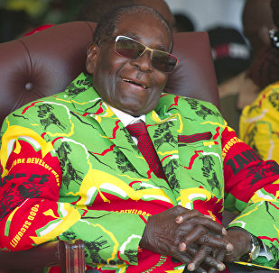 In this Friday June, 2, 2017 file photo Zimbabwean President Robert Mugabe smiles during a youth rally in Marondera, east of Harare.