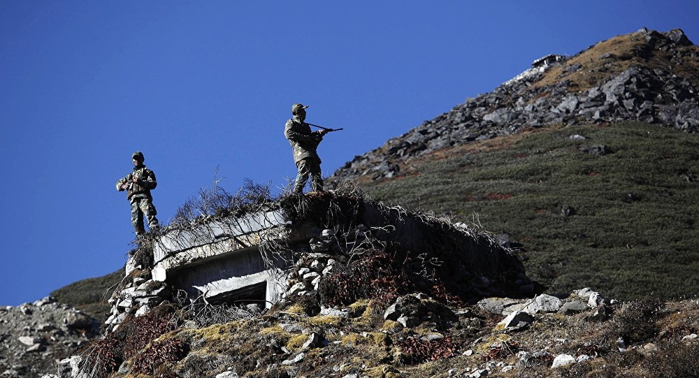 Indian Army soldiers keep watch on the border with China in Bumla at an altitude of 15,700 feet (4,700 meters) above sea level in Arunachal Pradesh, India. (File)