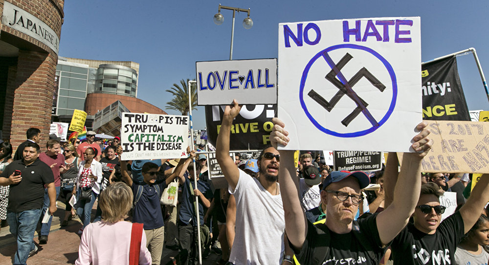 Demonstrators march in downtown Los Angeles on Sunday, Aug. 13, 2017. Protesters decrying hatred and racism converged around the country Sunday, the day after a white supremacist rally that spiraled into violence in Charlottesville, Va