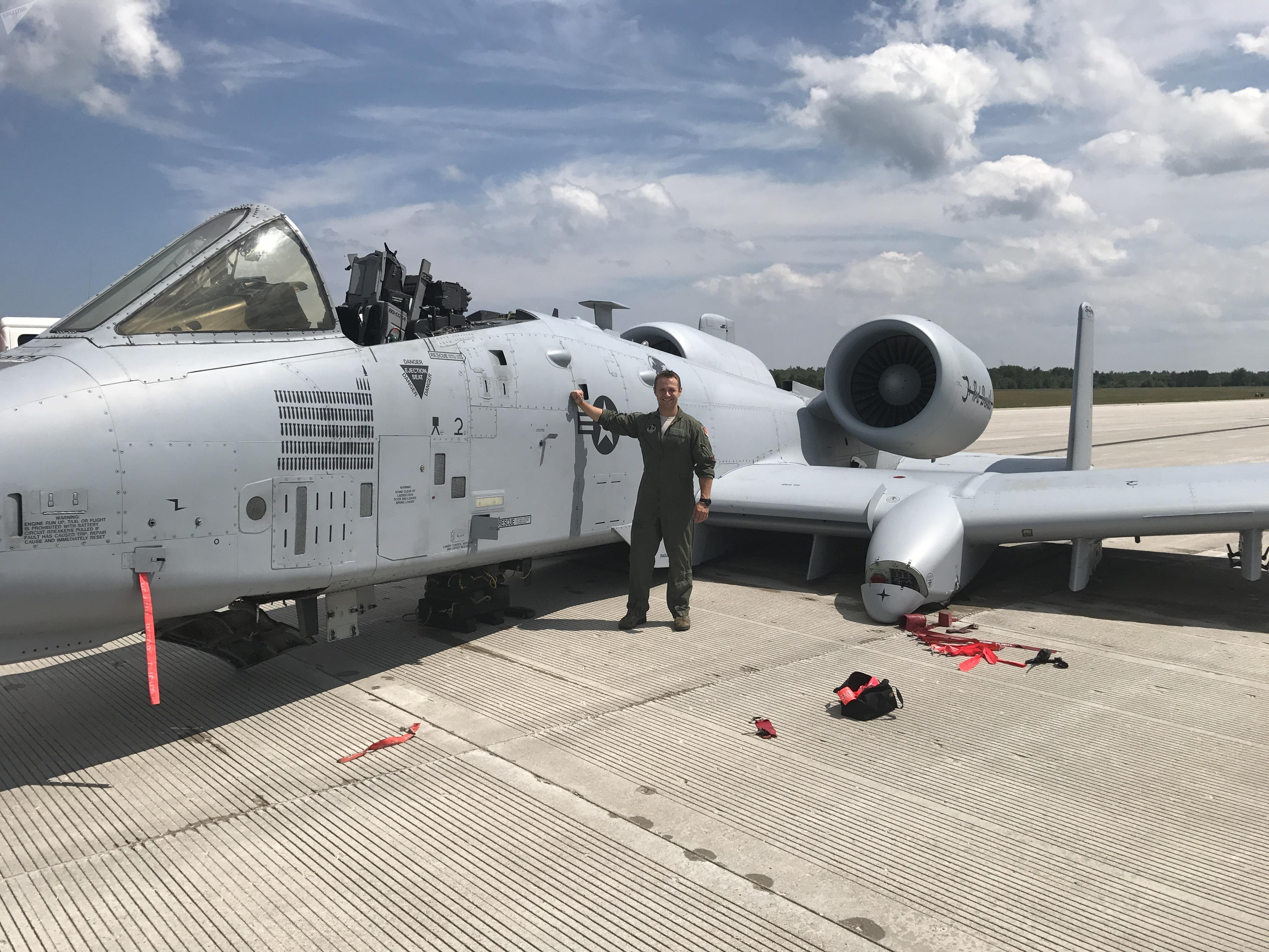 Capt. Brett DeVries, an A-10 Thunderbolt II pilot of the 107th Fighter Squadron from Selfridge Air National Guard Base, poses next to the aircraft he safely landed after a malfunction forced him to make an emergency landing July 20 at the Alpena Combat Readiness Training Center.
