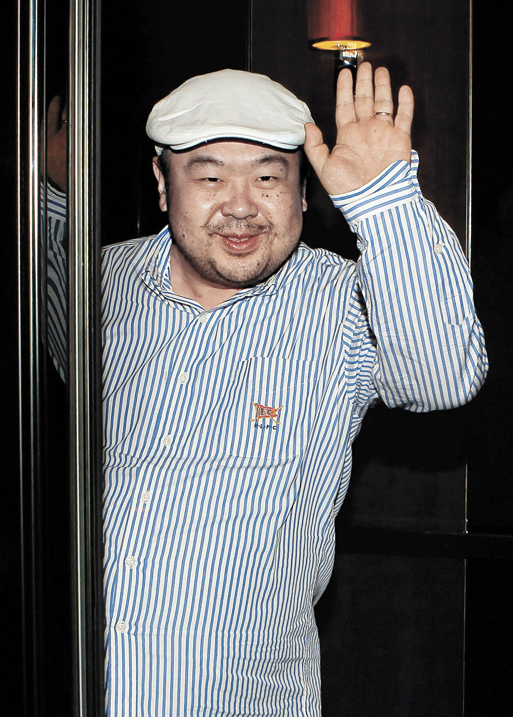 In this June 4, 2010 file photo, Kim Jong-nam, the eldest son of North Korean leader Kim Jong Il, waves after his first-ever interview with South Korean media in Macau, China