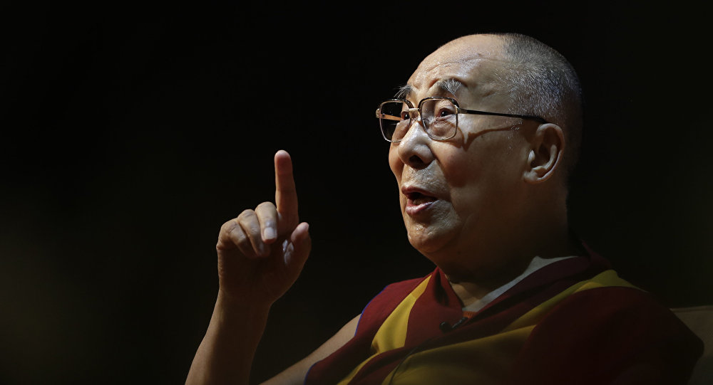 Tibetan spiritual leader the Dalai Lama speaks on the art of happiness at a public event in New Delhi, India, Thursday, Aug. 10, 2017