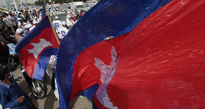 Cambodian National flags flutter over an opposition party supporters of the Cambodia National Rescue Party (CNRP) during the last day of campaigning ahead of communal elections, in Phnom Penh, Cambodia, Friday, June 2, 2017