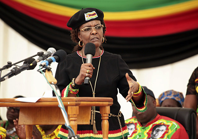 Zimbabwean first lady Grace Mugabe addresses party supporters at an event on the outskirts of Harare, Friday, Feb. 17, 2017.