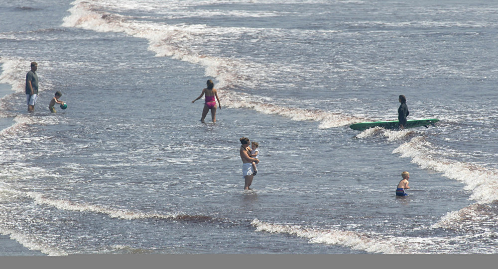 Beach-goers cool off in the water off Easton's Beach in Middletown, R.I., Tuesday, July 18, 2006, as temperatures in the Northeast soared into the 90s.