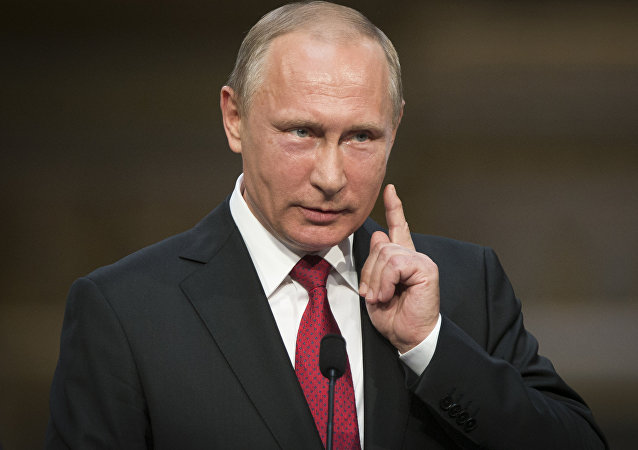 Russian President Vladimir Putin gestures as he speaks during a news conference.