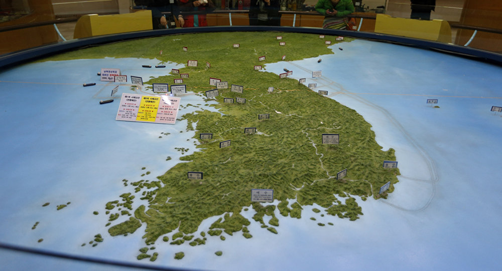 In this Feb. 10, 2016, file photo, visitors look at a map of the Korean peninsula at the exhibition hall of the unification observatory in Paju, South Korea