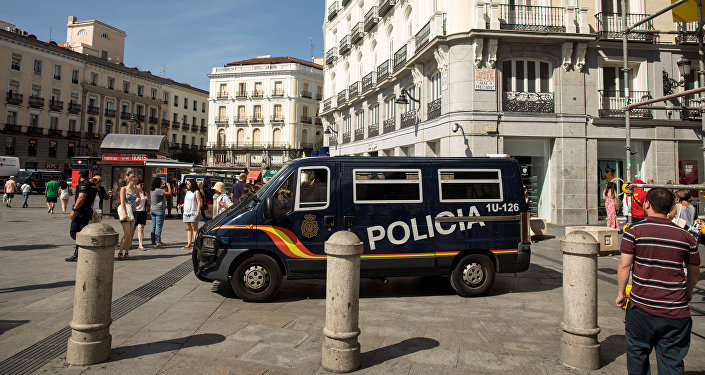A police van drives by at Madrid's Puerta del Sol square, Spain, August 18, 2017