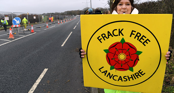 (File) Protesters hold placards at the Preston New Road site where Energy firm Cuadrilla are setting up fracking (hydraulic fracturing) operations at Little Plumpton near Blackpool in northwest England on January 10, 2017