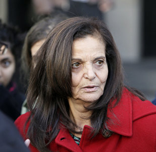 In this Nov. 10, 2014, file photo, Rasmieh Odeh, of Chicago, speaks to the media outside federal court in Detroit