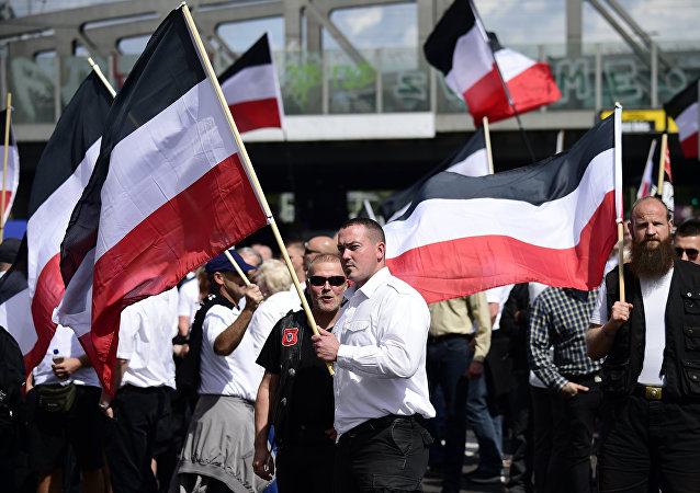 Extreme right-wings demonstrators gather prior to a neo-Nazi rally on the occasion of the 30th anniversary of the death of Hitler's deputy Rudolf Hess in Berlin Spandau on August 19, 2017.