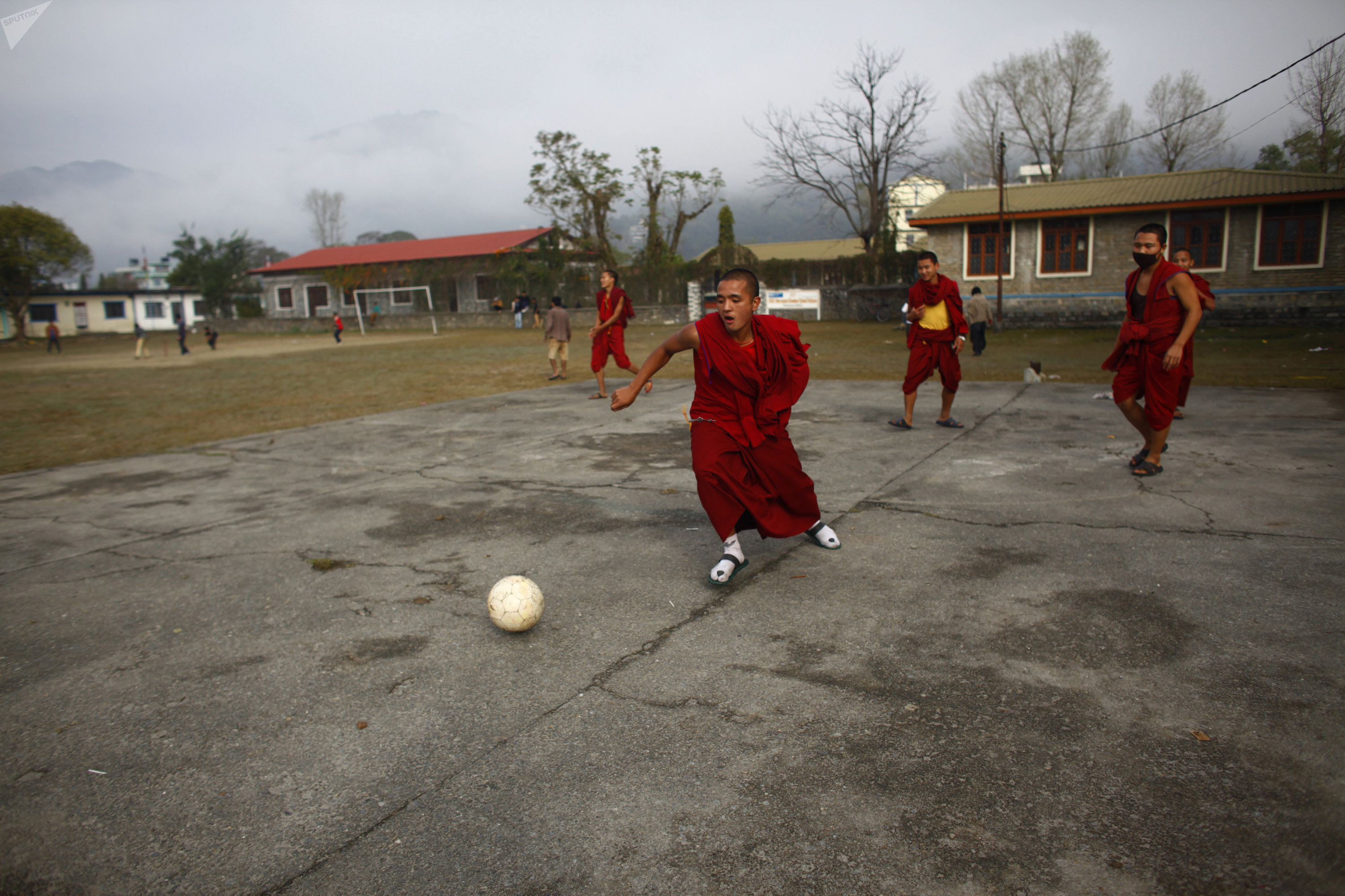 Tibetan monks play football inside a Tibetan Monastery in Pokhara, 200 kilometers (125 miles) from Katmandu, Nepal. (File)