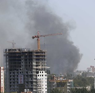 Smoke rises from residential buildings on fire in Rostov-on-Don, Russia August 21, 2017.